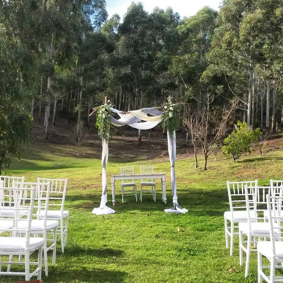 Ceremony at Stonebarn with our chairs and arbour, florals by Scentiment Flowers